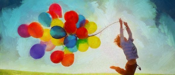 Chlapec s barevnými balónky.